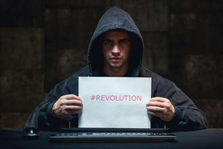 cyber terrorism: Photo of young hacker and cyber revolution aggainst terrorism