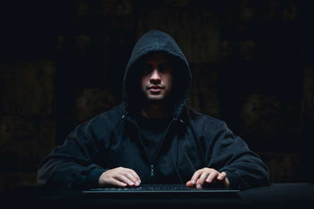 cyber terrorism: Picture of male hacker stealing on internet Stock Photo