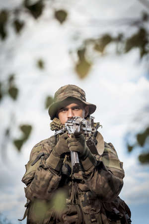 fatigues: Vertical picture of military soldier with weapon