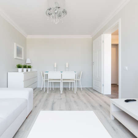 wood furniture: Photo of modern style flat interior with white furniture