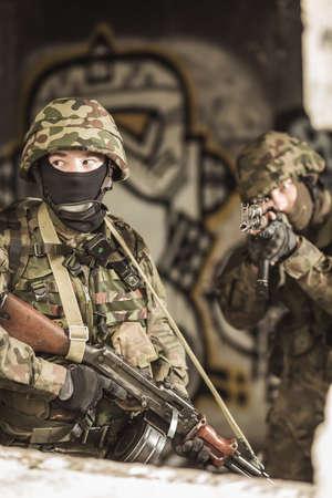 khakis: Heavily armed soldier in battle dress uniform