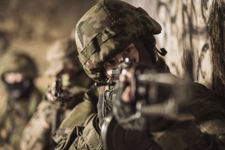 khakis: Picture of special forces soldier with weapon