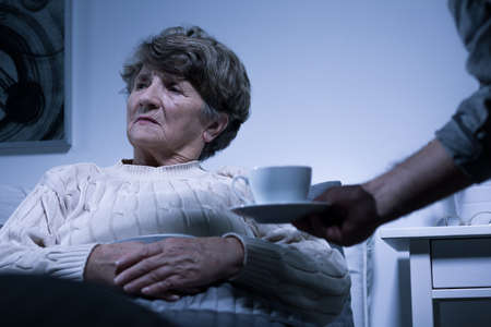 afflictions: Photo of ill elderly woman with negative attitude Stock Photo