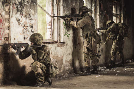 weapon: Military soldiers during training exercise with weapon Stock Photo
