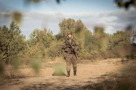 military training: Horizontal picture of soldier on battle field