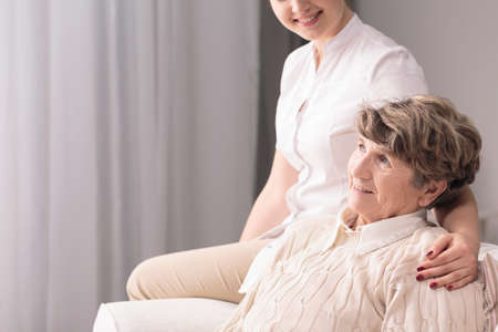 afflictions: Image of retired person and helpful caregiver Stock Photo