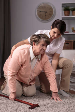 home healthcare: Photo of professional private caregiver and injured senior