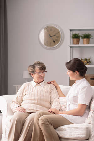 afflictions: Photo of carer supporting elderly woman with health afflictions Stock Photo
