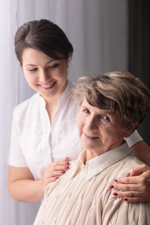 afflictions: Picture of rest home resident and professional carer