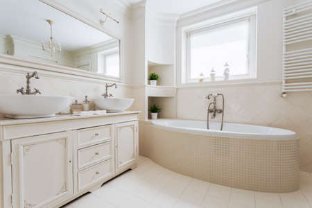 luxurious: Horizontal picture of luxurious bathroom with window in french style