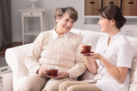 visiting: Image of nurse visiting ill senior patient at home Stock Photo