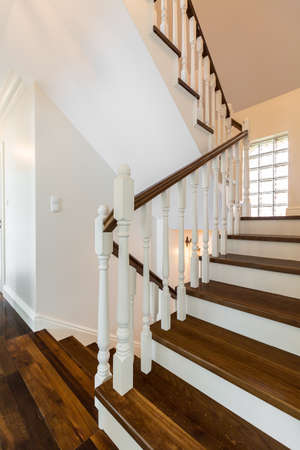 wooden stairs: Vertical photo of wooden stairs in a luxurious storey house Stock Photo