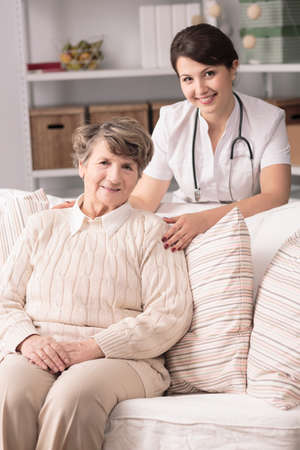 home visit: Image of senior patient and doctor during home visit