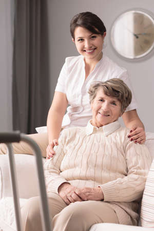 afflictions: Picture of disabled elderly woman and happy caregiver