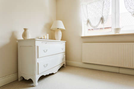 wardrobe closet: Photo of chest of drawers in wardrobe of extravagant house Stock Photo