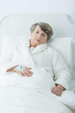 geriatric: Photo of sad geriatric ward patient after operation Stock Photo