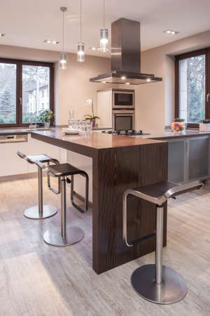 worktop: Image of spacious stylish open kitchen with decorative worktop Stock Photo