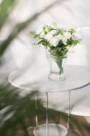 delicate: Beautiful delicate white flowers on the glass table Stock Photo