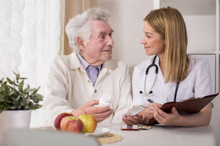 health professional: Photo of doctor and ill elderly man with medicines