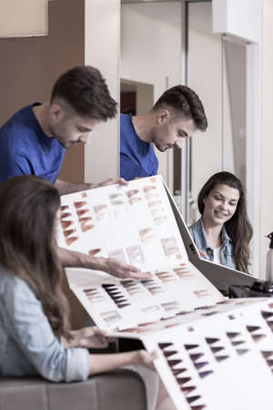 color hair: Hairstylist advising hair color from hair color chart Stock Photo