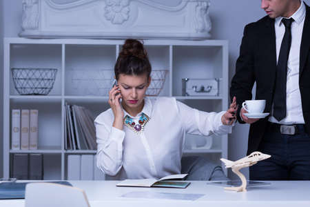 refusing: Photo of busy businesswoman refusing coffee cup Stock Photo