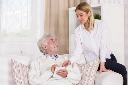 granddaughter: Image of granddaughter with ill old grandfather