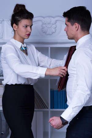 workplace harassment: Workplace mobbing - hombre de negocios que tiene demasiado trabajo