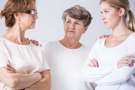 Photo of senior woman resolving conflict between mother and daughter