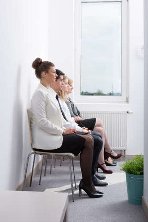 candidates: Image of candidates waiting for job interview in corporation