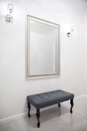anteroom: Small bench and big mirror in exclusive anteroom Stock Photo