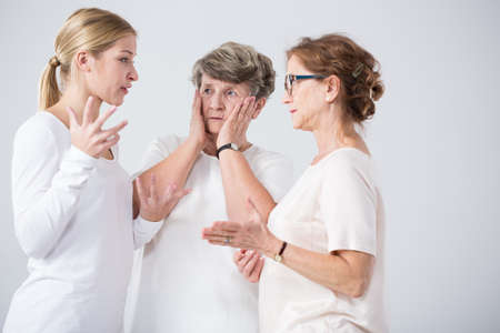 senior adult woman: Photo of argue between mother and daughter and worried grandma