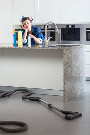 pedantic: Vertical view of unhappy woman cleaning house