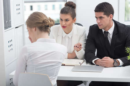 new employee: Photo of human resources directors talking with new employee