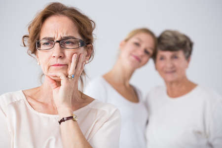 relatives: Photo of pensive mature woman with female relatives