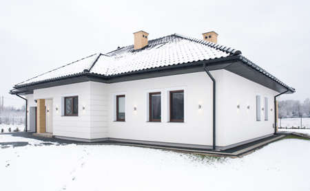 snow house: Exterior of single family house during winter time Stock Photo