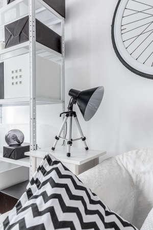 rack arrangement: Modern reading lamp in black and white room