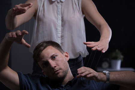 controlling: Bossy young woman and her malleable husband