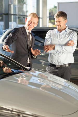 advantages: Car dealer is talking about advantages of the car