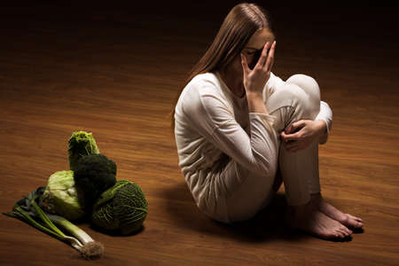 anorexia: Image of crying anorexic girl rejecting food Stock Photo