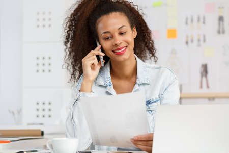 afroamerican: Image of afroamerican female and her own design studio Stock Photo