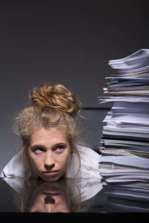 backlog: Young woman trying to overcome burnout at work