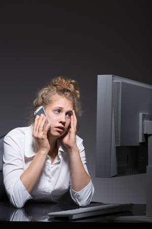 worn out: Young woman is worn out by work Stock Photo
