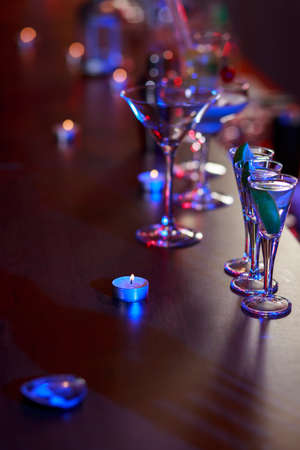 glass table: Alcohol drinks standing on the cocktail bar