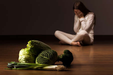 nutrition health: Image of despair woman suffering from eating disorder