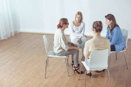 additional training: Female psychotherapist with support group during classes
