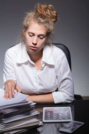 jaded: Young employee has problem with managing paperwork