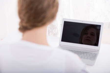 harassing: Picture of teenage female stalker with new laptop Stock Photo