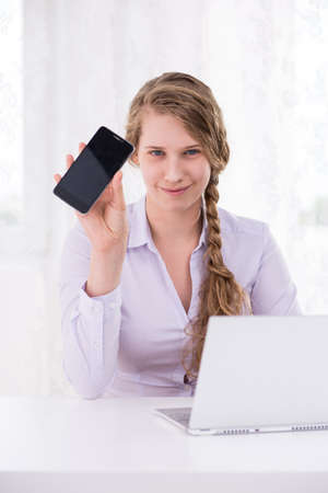 harassing: Image of teenage girl with mobilephone having bad intention Stock Photo