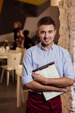 gastronomy: Image of handsome male restaurant worker enjoying his work