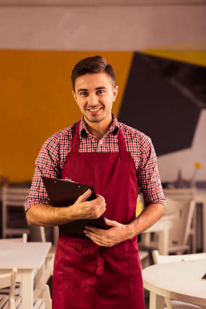 enterprising: Image of enterprising man leading small gastronomy business Stock Photo
